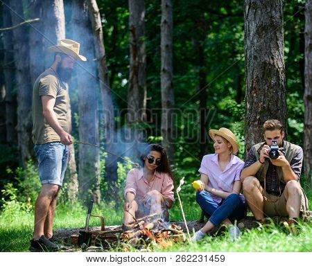 Camping And Hiking. Company Friends Relaxing And Having Snack Picnic Nature Background. Company Hike