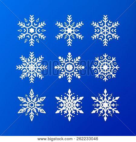 Snowflake Icon Set. White Color Snowflakes Isolated On Blue Background. Winter Christmas Snowflake C