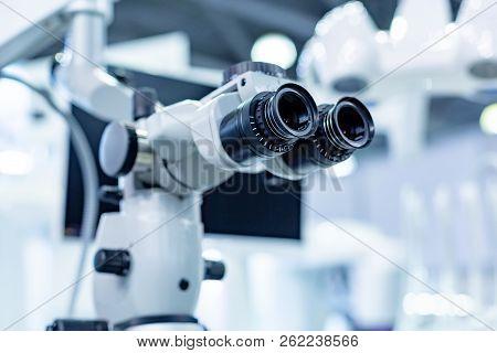 Dental Microscope On The Background Of Modern Dentistry. Medical Equipment. Dental Operating Microsc