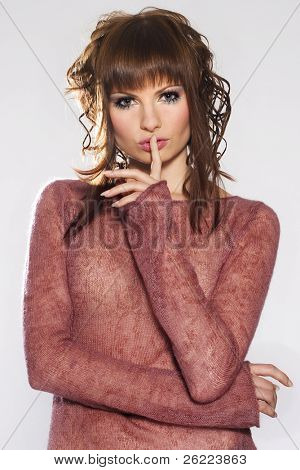 a portrait of a beautiful brunette girl on white background