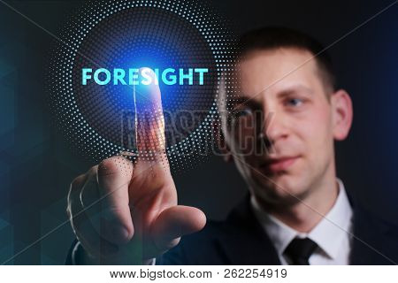 Business, Technology, Internet and network concept. Young businessman working on a virtual screen of the future and sees the inscription: Foresight poster