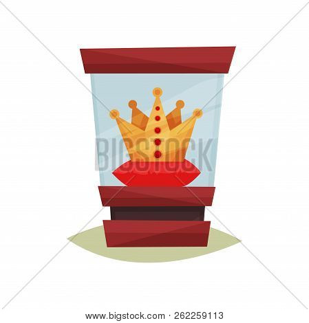 Golden Crown With Red Gems On Pedestal Under Glass Box. Valuable Exhibit. Headwear Of King. Museum O