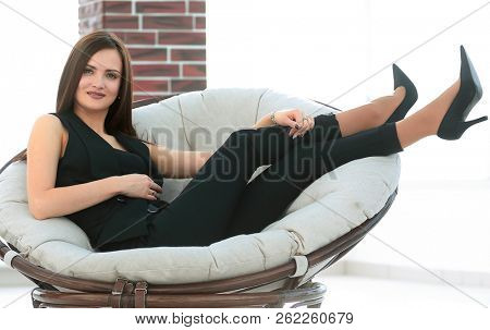 elegant business woman sitting in a comfortable chair.