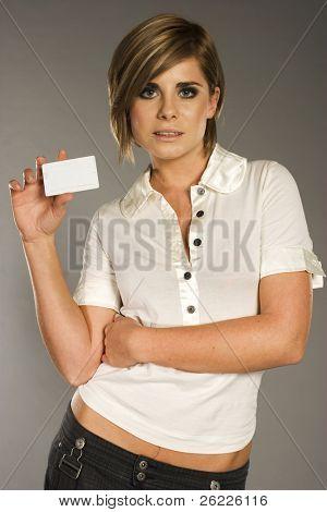 beautiful smiling woman holding a membership card bank card or credit card