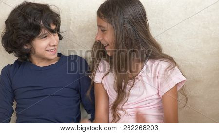 Portrait Of Adorable Brother And Sister, Teenagers Smiling And Laughing With Funny Expression On The