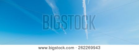 Blue Sky With Contrails In The Summer
