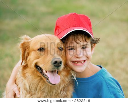 Boy And Golden Retriever