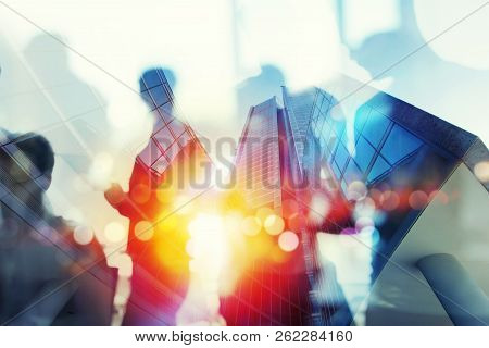 Silhouette Of Business People Work Together In Office. Concept Of Teamwork And Partnership. Double E