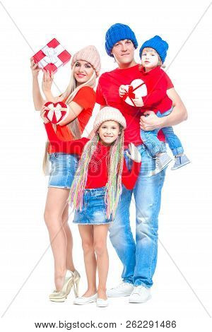 Family At Christmas. Cheerful Family In Hats Looking At Camera And Smiling While Isolated On White.