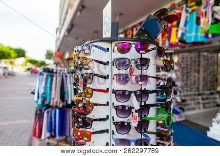 Alanya / Turkey - September 30, 2018: Sunglasses From Ray-ban Hangs On A Stand At A Local Market In