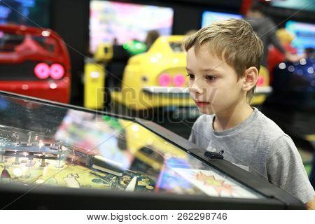 Kid Playing Arcade Game In Redemption Center