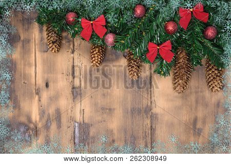 Decorated Wooden Background With Christmas Tree Branches With Cone. New Year Card