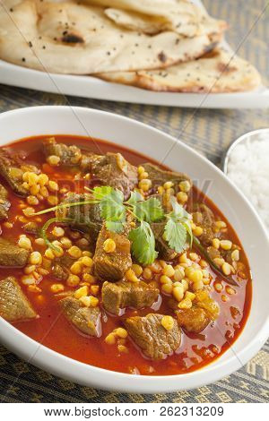 Delicious Lamb Curry With Channa Dahl, A Speciality Of Lahore In Pakistan, Served With Naan Bread.