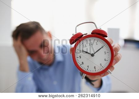 Smiling Business Woman Holding In Hand On The Alarm