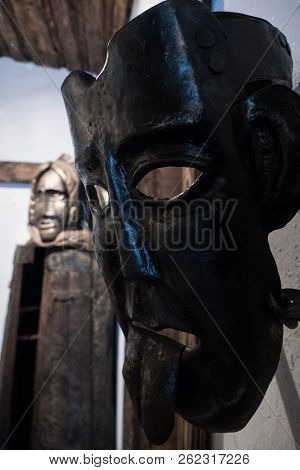 a detali of medieval torture mask with a scarry face poster