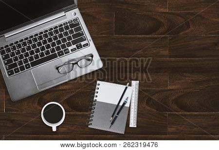 Home Office Desktop Workplace With Laptop With Eyeglasses And Notebook With Copy Space. Business Off