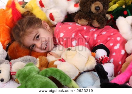 3 Year Old Baby Girl Playing With Her Toys