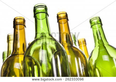Empty Glass Wine Bottles, Washed And Ready For Recycling. Shallow Dof, Focus On Foreground.