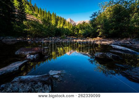 Maroon Bells Mirrored Reflections Of Perfect Lush Forests And Pond Reflections With The Massive Peak