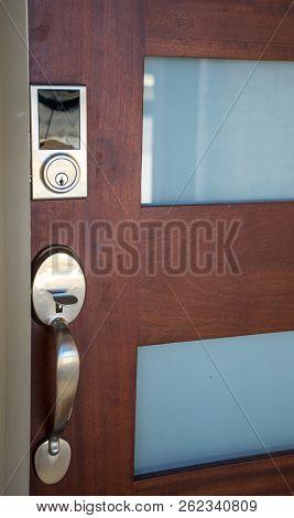 Front Door With Metal Door Lock And New Technology Digital Key Code Device On Nice Solid Wood Door W