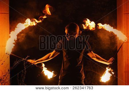Fire Show. Fakir Dances With Two Staff. Night Performance.