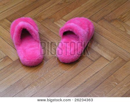 Pink mule on flooring