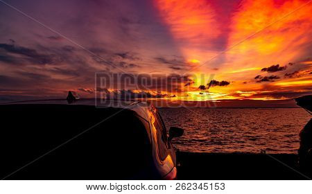 Silhouette Suv Car With Sport And Modern Design Parked On Concrete Road By The Sea At Sunset. Road T