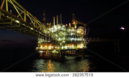 Oil And Gas Industry And Hard Work At Night Time. Offshore Construction Platform For Production Oil
