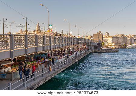 Istanbul, Turkey - April 25, 2017: Galata Bridge With Traditional Fish Restaurants In The Passage Un