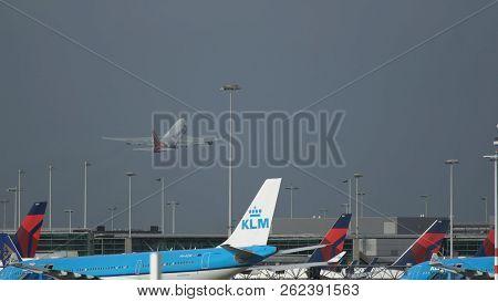 Amsterdam, Netherlands - July 26, 2017: Long Distance Shot Of Martinair Cargo Boeing 747 Gaining Alt