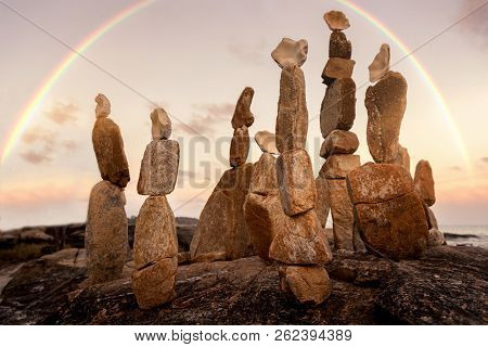 Balance Stones Stacked In  Sunset On The Beach. Freedom And Stability On Rocks Concept.