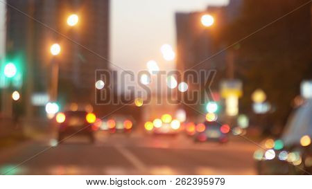 Driving At Night. View The Windshield And Blurred Cars In The City. Window Of The Front Car With A B