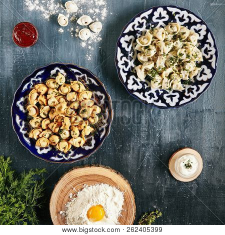 Cooking Dumplings with Various Types of Cooked It on Natural Black Background Top View. Oriental Fried and Boiled Ravioli, Pelmeni, Gyoza, Dim Sum, Jiaozi, Momo, Tortellini or Mandu Collection