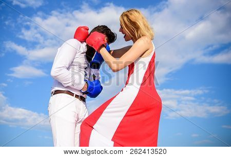Learn How To Defend Yourself. Man And Woman Boxing Gloves Fight Sky Background. She Knows How To Def
