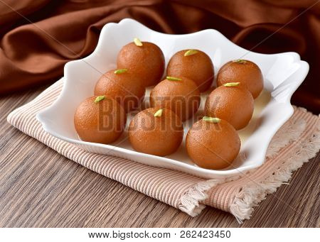 Gulab Jaman, A most famous Indian sweet, cottage cheese balls soaked in sugar syrup. poster