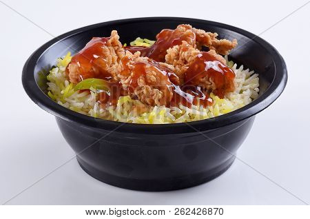 Rice with Crispy fried Chiicken,scrumptious blend of deep fried chicken with nicely cooked rice. poster