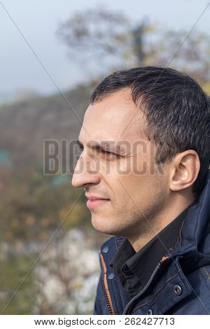 Handsome Man Walking In The Autumn Park. Portrait, Profile, Close-up