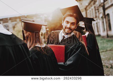 Guy. Courtyard. Mantle. University. Classmates. Cheerful. Celebration. Happiness. Intelligence. Dipl