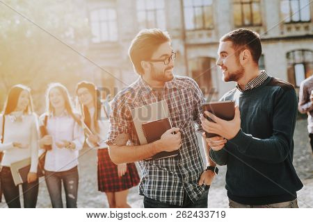 Courtyard. Holding Books. Notepad. Guys. Standing In University. Good Mood. Intelligence. Standing T