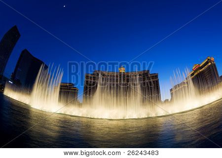 LAS VEGAS, NV - MAY 20:  Fountains at Bellagio Hotel and Casino at sunset. The fountain show is accompanied by lights and popular tunes and runs every 15 or 30 minutes. May 20, 2010, Las Vegas, NV.