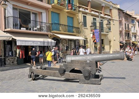 Collioure, France - September 5, 2018: On The Quays Of The Port Of Collioure An Old Gun Is Directed