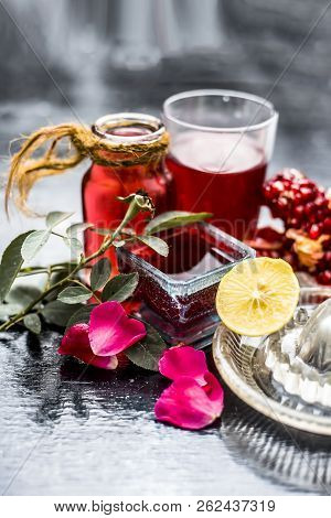 Close Up Of Herbal Face Pack Of Pomegranate And Lemon Juice With Rose Water On Wooden Surface With S