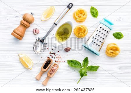 The Ingredients For Homemade Pesto Pasta On White Wooden Background.