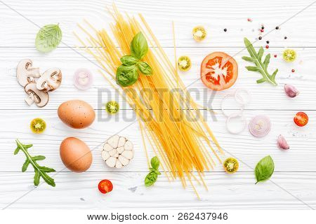 Ingredients For Homemade Pasta On Wooden Background.