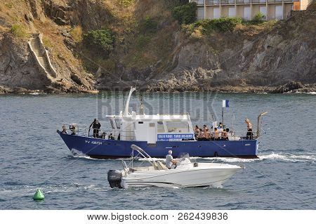 Collioure, France - September 5, 2018: Diving School Boat In The Collioure Cove Coming Back From The