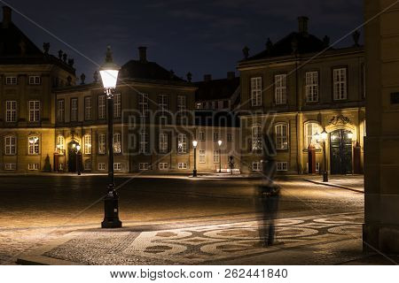 Amalienborg, the palace and residence in Copenhagen of the queen of Denmark by night with the royal guards. poster