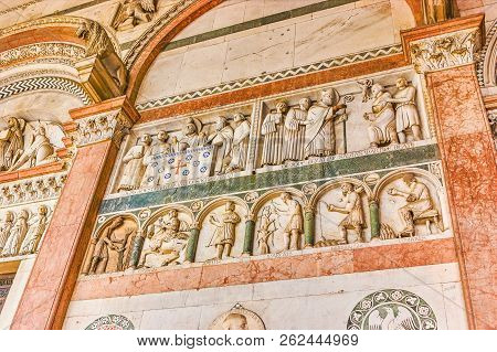 The Marble Sculptures On Different Themes On The Frontage Of Saint Martin Of Tours Cathedral, Lucca,