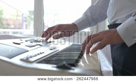 Musician Playing Synthesizer. The Musician Plays The Piano. Male Hands Play The Synthesizer.