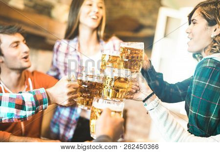 Happy Friends Group Drinking And Toasting Beer At Brewery Bar Restaurant - Friendship Concept With Y