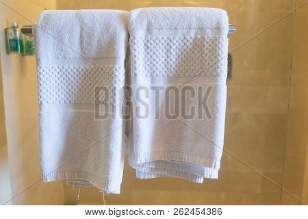 Clean White Towels On A Hanger At Bathroom